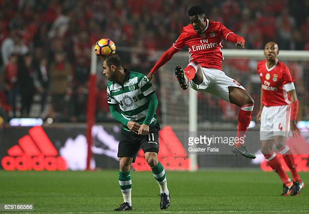 Benfica's defender Nelson Semedo with Bruno Cesar in action during the Primeira Liga match between SL Benfica and Sporting CP at Estadio da Luz on...