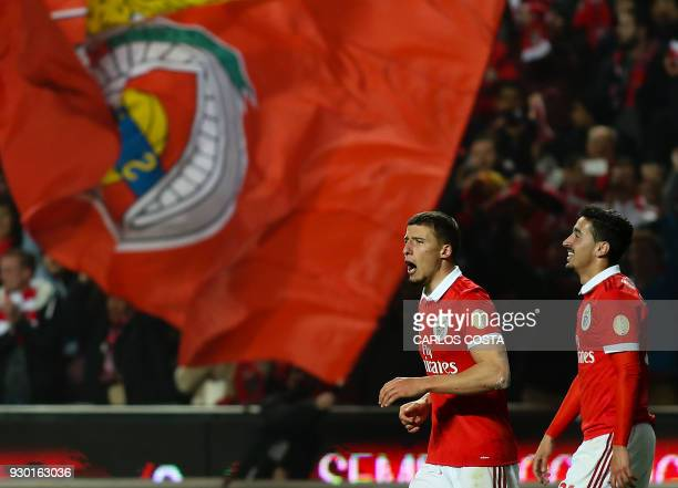 Benfica's defender Ruben Dias celebrates a goal with Benfica's defender Andre Almeida during the Portuguese league football match between SL Benfica...