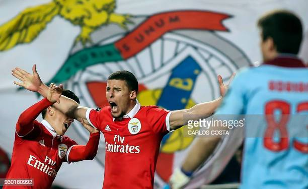 Benfica's defender Ruben Dias celebrates a goal with Benfica's Argentinian forward Franco Cervi during the Portuguese league football match between...
