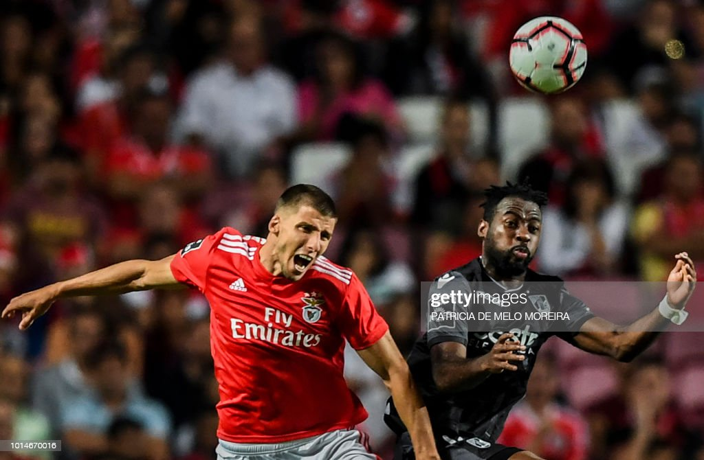 Benfica's defender Ruben Dias (L) heads the ball with Guimaraes' Ivorian forward Tallo Junior during the Portuguese league football match between SL Benfica and Vitoria Guimaraes SC at the Luz stadium in Lisbon on August 10, 2018.