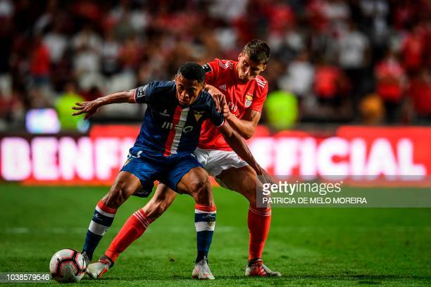 Benfica's defender Ruben Dias vies with Aves' Brazilian forward Vanderley Marinho during the Portuguese league football match between SL Benfica and...
