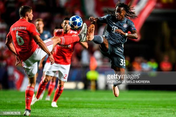 Benfica's defender Ruben Dias vies with Bayern's Portuguese midfielder Renato Sanches during the UEFA Champions League group E football match Benfica...
