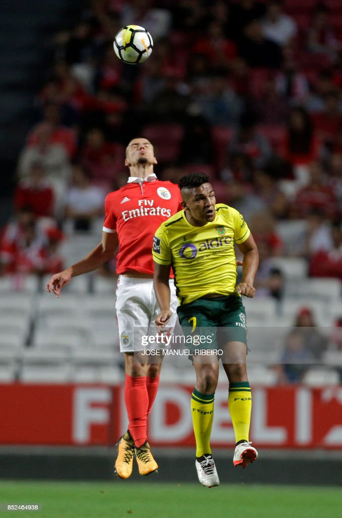 Benfica's defender Ruben Dias (L) vies with Pacos Ferreira's Brazilian forward Welthon Sampaio during the Portuguese league football match SL Benfica vs FC Pacos de Ferreira at the Luz stadium in Lisbon on September 23, 2017. /