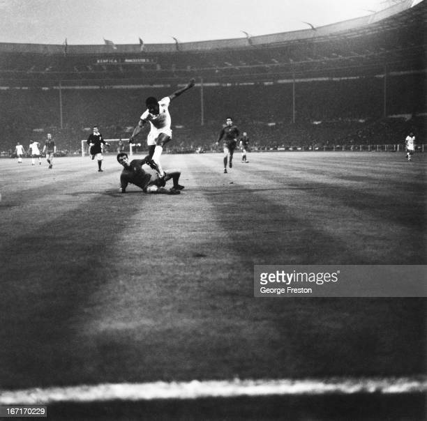 Benfica's Eusebio beats David Sadler to shoot for goal during the European Cup Final against Manchester United at Wembley Stadium, 29th May 1968. The...