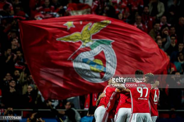 Benfica's football players celebrate after Benfica's Portuguese midfielder Rafa Silva scored a goal during the UEFA Champions League Group G football...