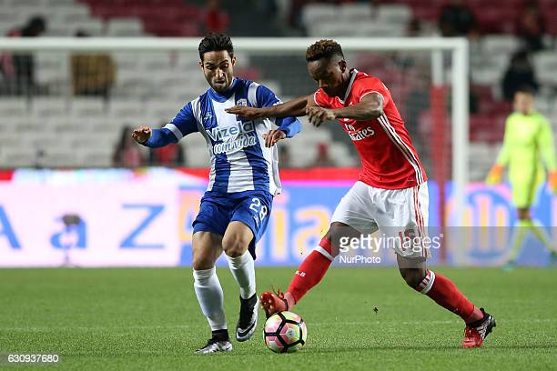 Benfica's forward Andre Carrillo vies with Vizela's midfielder Tiago Ronaldo during the Portuguese League Cup football match SL Benfica vs FC Vizela...