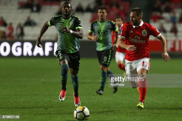 Benficas forward Andrija Zivkovic from Serbia and Setubals forward Arnold Issoko during the Premier League 2017/18 match between SL Benfica and FC...