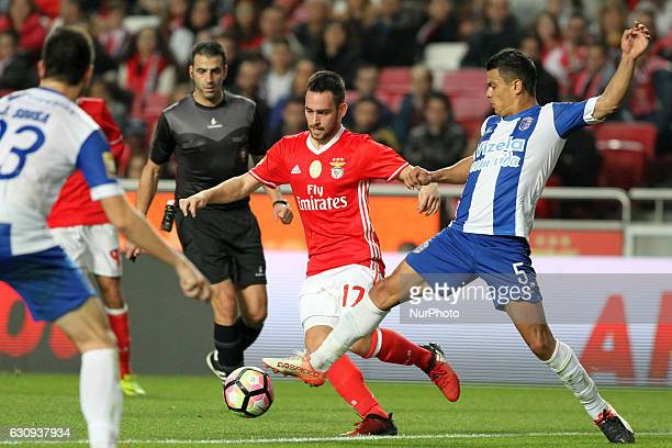 Benfica's forward Andrija Zivkovic vies with Vizela's midfielder Alex Porto during the Portuguese League Cup football match SL Benfica vs FC Vizela...