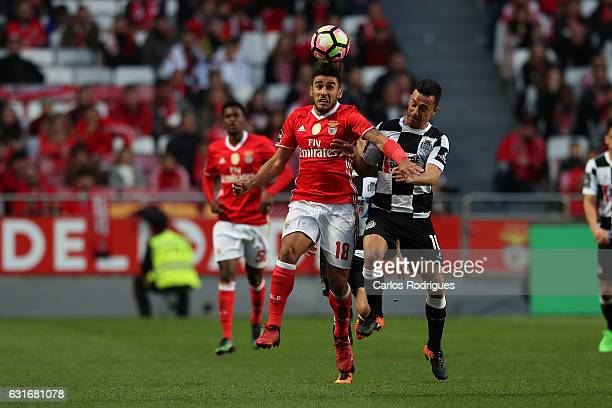 Benfica's forward Eduardo Salvio from Argentina vies with Boavista's midfielder Fabio Espinho from Portugal during the match between SL Benfica and...