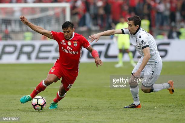 Benfica's forward Eduardo Salvio vies for the ball with Vitoria SC's midfielder Rafael Miranda during the Portugal Cup football final match between...