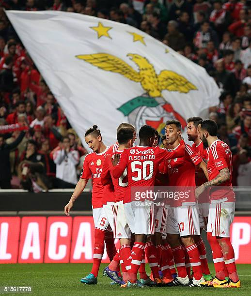 Benfica's forward from Brazil Jonas celebrates with teammates after scoring a goal during the Primeira Liga match between SL Benfica and CD Tondela...