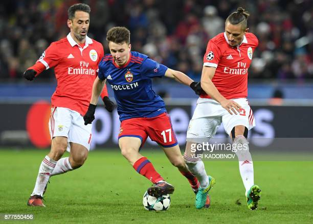 Benfica's forward from Brazil Jonas CSKA Moscow's midfielder from Russia Aleksandr Golovin and Benfica's midfielder from Serbia Ljubomir Fejsa vie...