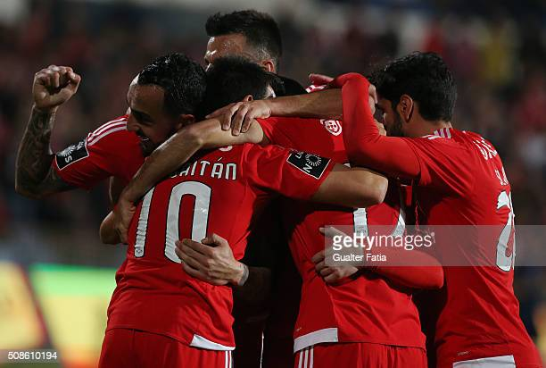 Benfica's forward from Greece Kostas Mitroglou celebrates with teammates after scoring a goal during the Primeira Liga match between Os Belenenses...
