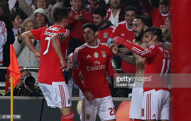 Benfica's forward from Greece Kostas Mitroglou celebrates with teammates after scoring a goal during the Primeira Liga match between SL Benfica and...