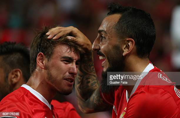 Benfica's forward from Greece Kostas Mitroglou celebrates with teammate SL Benfica's midfielder Andre Horta after scoring a goal during the Primeira...