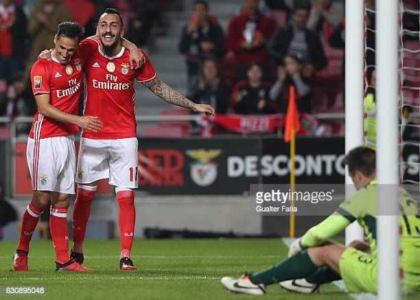 Benfica's forward from Greece Kostas Mitroglou celebrates with teammate SL Benfica's forward from Brazil Jonas after scoring a goal during the...