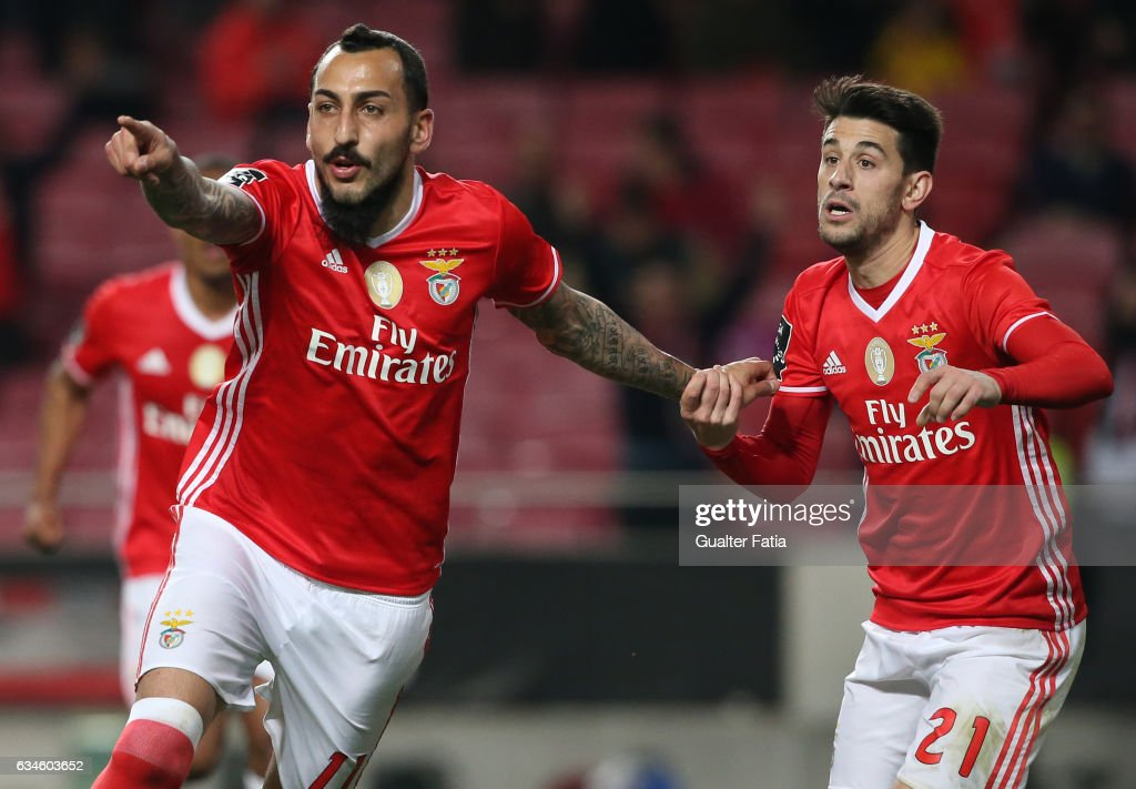 SL BenficaÕs forward from Greece Kostas Mitroglou celebrates with teammate SL BenficaÕs midfielder Pizzi after scoring a goal during the Primeira Liga match between SL Benfica and FC Arouca at Estadio da Luz on February 10, 2017 in Lisbon, Portugal.
