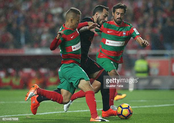 Benfica's forward from Greece Kostas Mitroglou with CS Maritimo's defender Patrick Vieira from Brazil and CS Maritimo's defender Mauricio Carvalho...