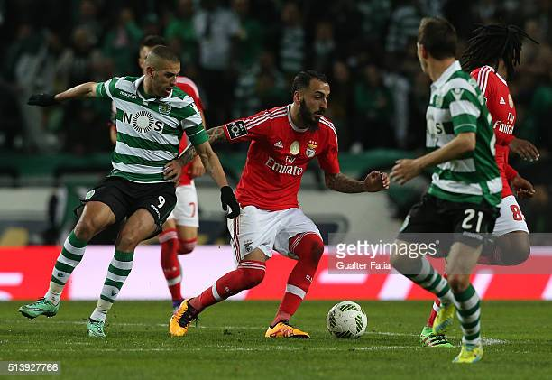 BenficaÕs forward from Greece Kostas Mitroglou with Sporting CPÕs forward Islam Slimani from Algeria in action during the Primeira Liga match between...