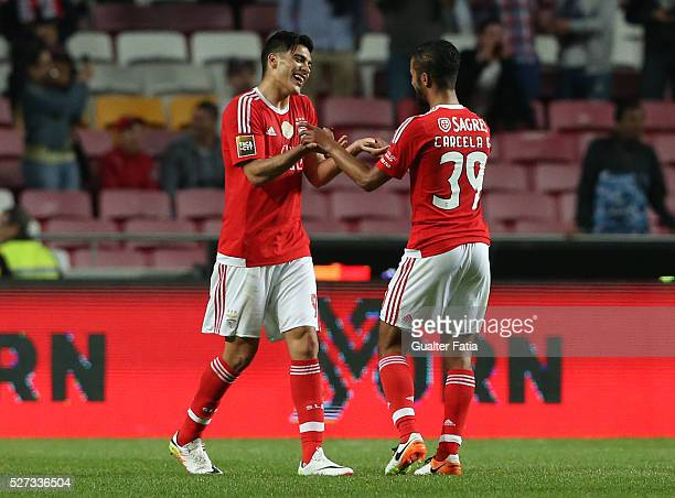 Benfica's forward from Mexico Raul Jimenez celebrates with teammate SL Benfica's midfielder from morocco Carcela after scoring a goal during the Taca...