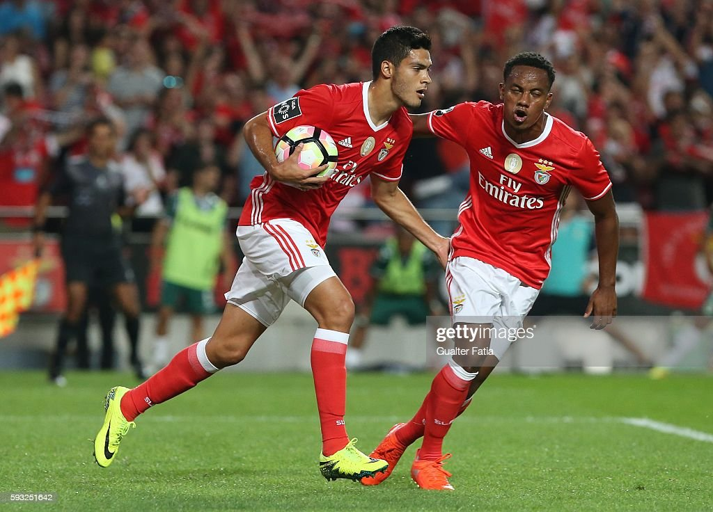 SL Benfica's forward from Mexico Raul Jimenez celebrates with teammate SL Benfica's forward from Peru Andre Carrillo after scoring a goal during the Primeira Liga match between SL Benfica and Vitoria de Setubal at Estadio da Luz on August 21, 2016 in Lisbon, Portugal.