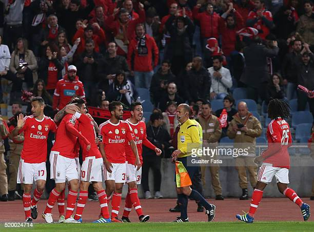 Benfica's forward from Mexico Raul Jimenez celebrates with teammates after scoring a goal during the Primeira Liga match between A Academica de...