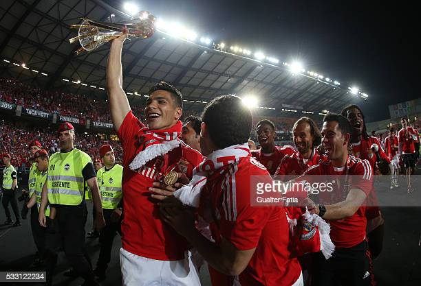 Benfica's forward from Mexico Raul Jimenez celebrates with trophy after winning the Portuguese League Cup Title at the end of the Taca CTT Final...