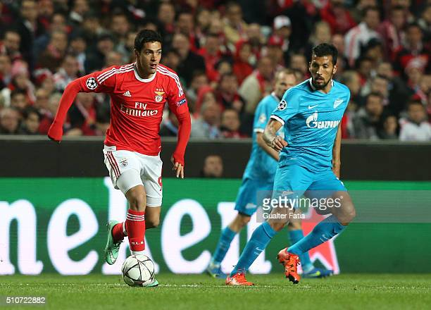 BenficaÕs forward from Mexico Raul Jimenez with FC ZenitÕs defender from Argentina Ezequiel Garay in action during the UEFA Champions League Round of...