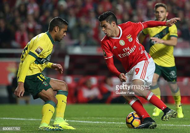 Benfica's forward from Mexico Raul Jimenez with Pacos Ferreira's defender Ricardo from Portugal in action during the Primeira Liga match between SL...