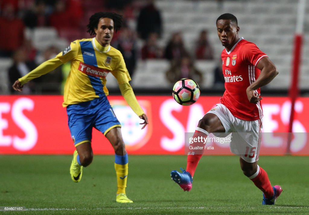 SL BenficaÕs forward from Peru Andre Carrillo (R) with Arouca's midfielder Kuca from Cabo Verde (L) in action during the Primeira Liga match between SL Benfica and FC Arouca at Estadio da Luz on February 10, 2017 in Lisbon, Portugal.