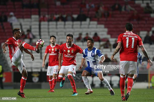 Benfica's forward from Peru Andre Carrillo with SL Benfica's midfielder from Greece Andreas Samaris and Vizela's midfielder Alex Porto from Brazil in...