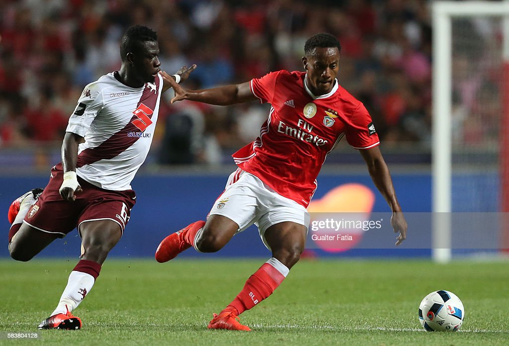 SL Benfica's forward from Peru Andre Carrillo with Torino's midfielder Afriyie Acquah in action during the Eusebio Cup match between SL Benfica and Torino at Estadio da Luz on July 27, 2016 in Lisbon, Portugal.