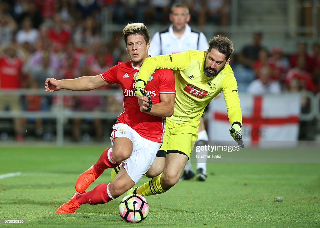 SL Benfica's forward from Serbia Luka Jovic with Derby County's goalkeeper Carson in action during the Algarve Football Cup Pre Season Friendly match between SL Benfica and Derby County at Estadio do Algarve on July 16, 2016 in Faro, Portugal.