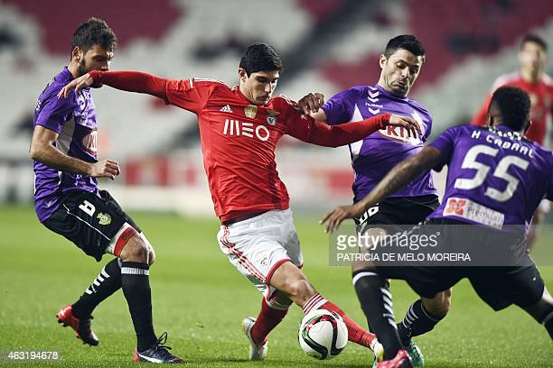 Benfica's forward Goncalo Guedes vies with Setubal's midfielder Paulo Tavares Setubal's midfielder Dani Soares and Setubal's defender Helder Cabral...