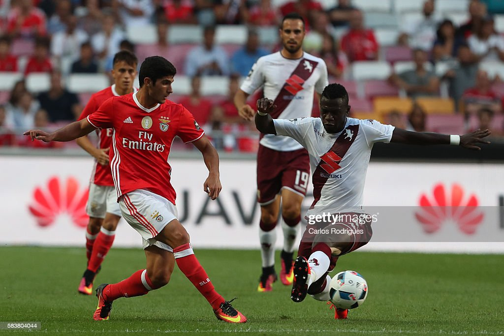 Benfica's forward Goncalo Guedes (L) vies with Torino's midfielder Afriyie Acquah (R) during the match between SL Benfica and Torino for the Eusebio Cup at Estadio da Luz on July 27, 2016 in Lisbon, Portugal.