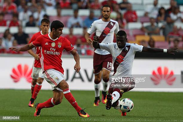 Benfica's forward Goncalo Guedes vies with Torino's midfielder Afriyie Acquah during the match between SL Benfica and Torino for the Eusebio Cup at...