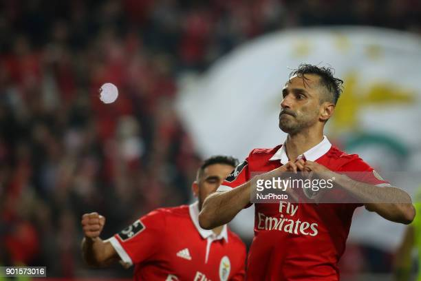 Benfica's forward Jonas celebrates after scoring during the Portuguese League football match between SL Benfica and Sporting CP at Luz Stadium in...
