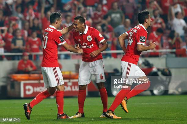 Benfica's forward Jonas celebrates his goal with Benfica's midfielder Filipe Augusto and Benfica's defender Andre Almeida during Primeira Liga...
