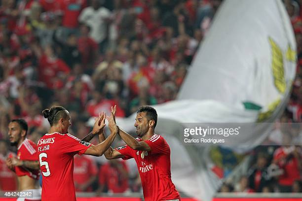 Benfica's forward Jonas celebrates scoring Benfica«s third goal goal with Benfica's midfielder Ljubomir Fejsa during the match between SL Benfica and...