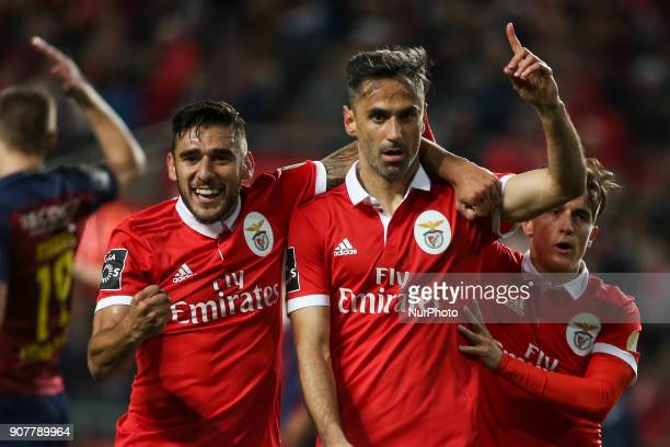 Benfica's forward Jonas celebrates with Benfica's forward Eduardo Salvio and Benfica's defender Alejandro Grimaldo after scoring a goal during the...