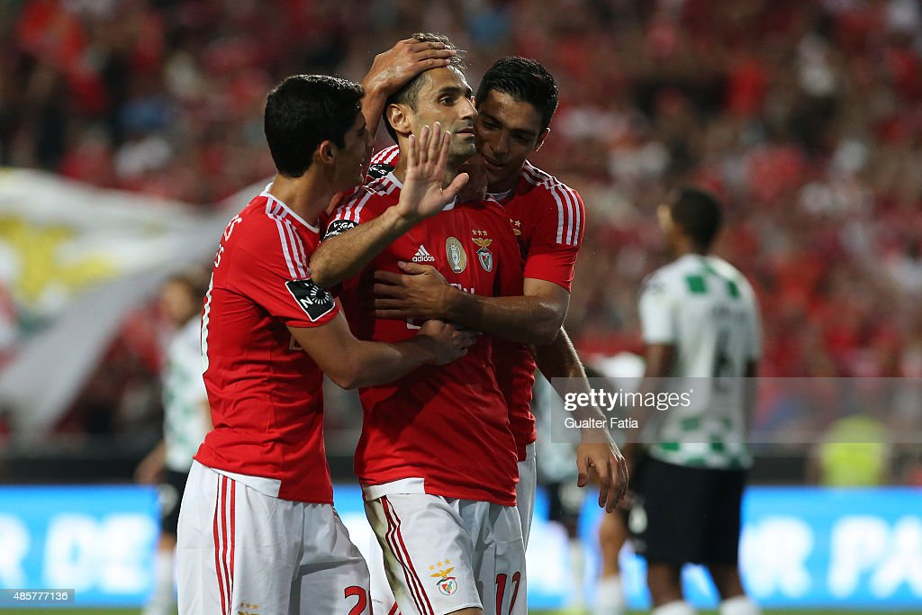 SL Benfica's forward Jonas celebrates with teammates after scoring a goal during the Primeira Liga match between SL Benfica and Moreirense FC at Estadio da Luz on August 29, 2015 in Lisbon, Portugal.