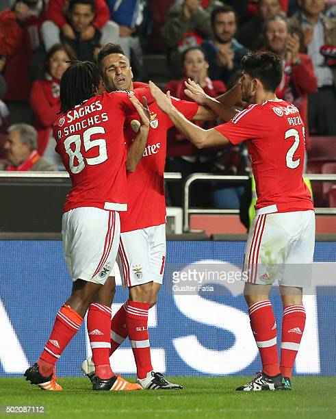 Benfica's forward Jonas celebrates with teammates after scoring a goal in action during the Primeira Liga match between SL Benfica and Rio Ave FC at...