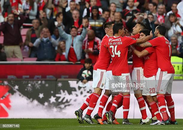 Benfica's forward Jonas celebrates with teammates after scoring a goal during the Primeira Liga match between SL Benfica and Rio Ave FC at Estadio da...