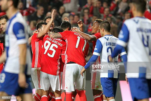 Benfica's forward Jonas celebrates with teammates after scoring during the Portuguese League Cup football match SL Benfica vs FC Vizela at the Luz...