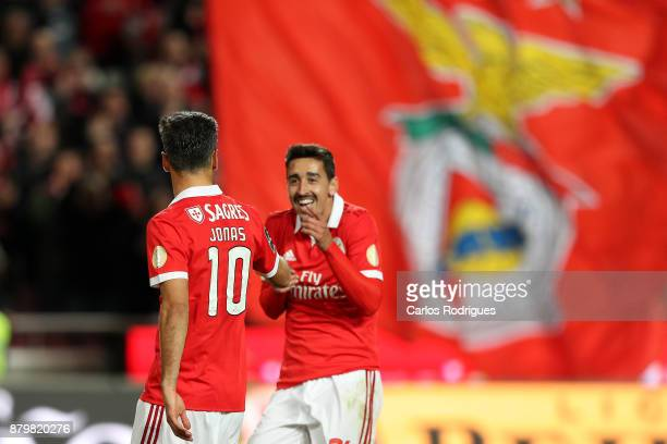 Benfica's forward Jonas from Brasil celebrates scoring Benfica fourth goal with Benfica's defender Andre Almeida from Portugal during the match...