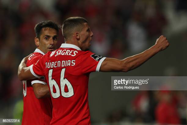 Benfica's forward Jonas from Brasil celebrates scoring Benfica second goal with Benfica's defender Ruben Dias from Portugal during the match between...