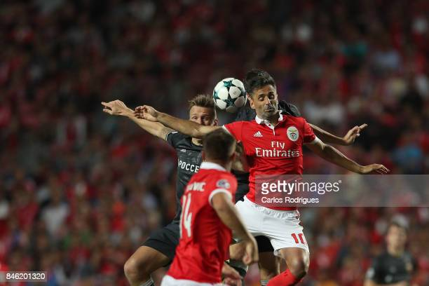 Benfica's forward Jonas from Brasil in the air wins the ball during SL Benfica v CSKA Moskva UEFA Champions League round one match at Estadio da Luz...
