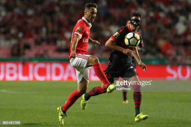 Benficas forward Jonas from Brazil and Bragas midfielder Nikola Vukcevic from Montenegro during the Portuguese Cup 2017/18 match between SL Benfica v...