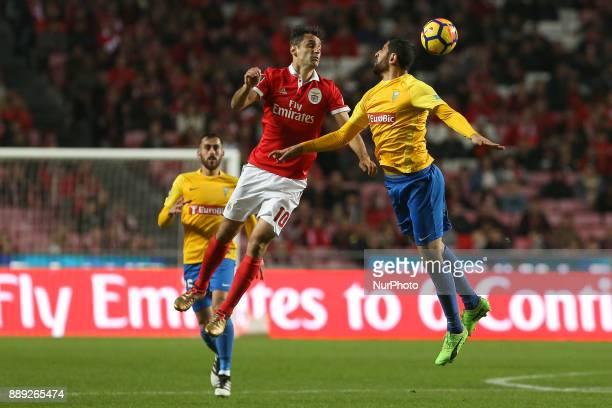 Benficas forward Jonas from Brazil and GD Estoril Praia defender Rafik Halliche from Algeria during the Premier League 2017/18 match between SL...