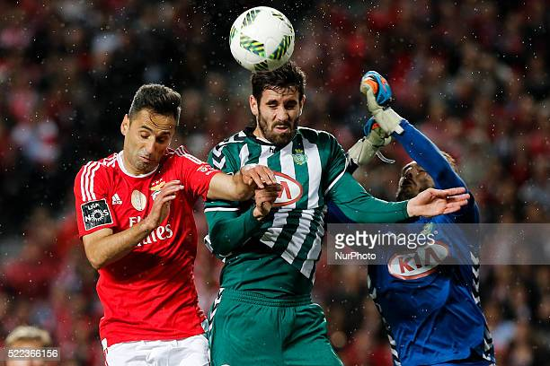 Benfica's forward Jonas heads for the ball with Setubal's defender Frederico Venancio and Setubal's goalkeeper Ricardo during the Portuguese League...